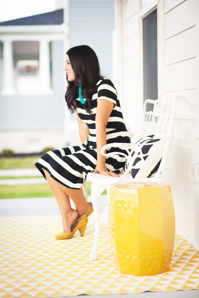 white house, wayfair, party, yellow door, black and white stripes, black and white dress, white exteriors, garden stool,