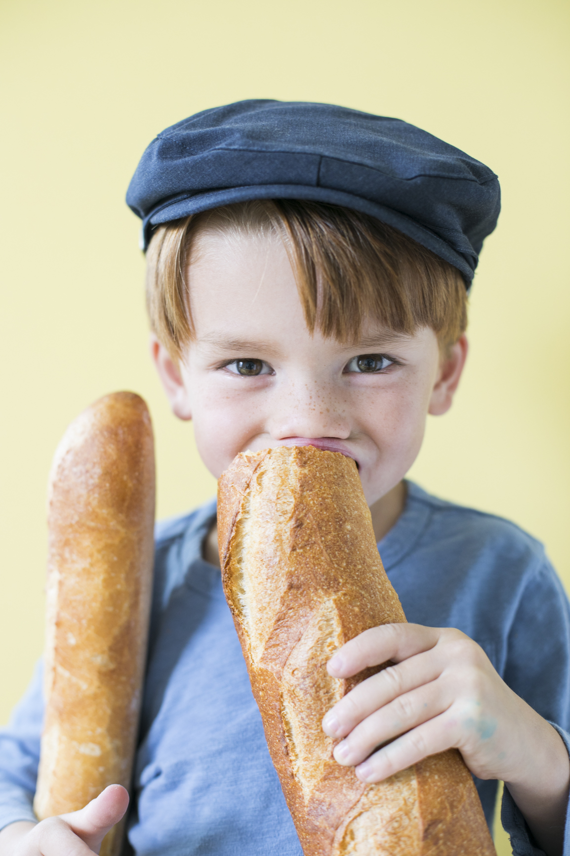 Child Eating a Baguette