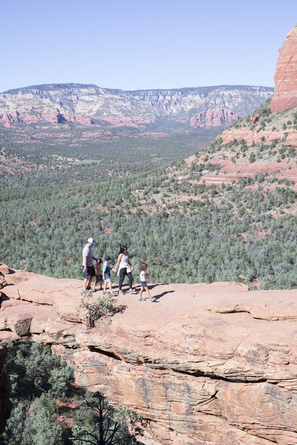 Family Walking on Devil's Bridge Sedona Arizona