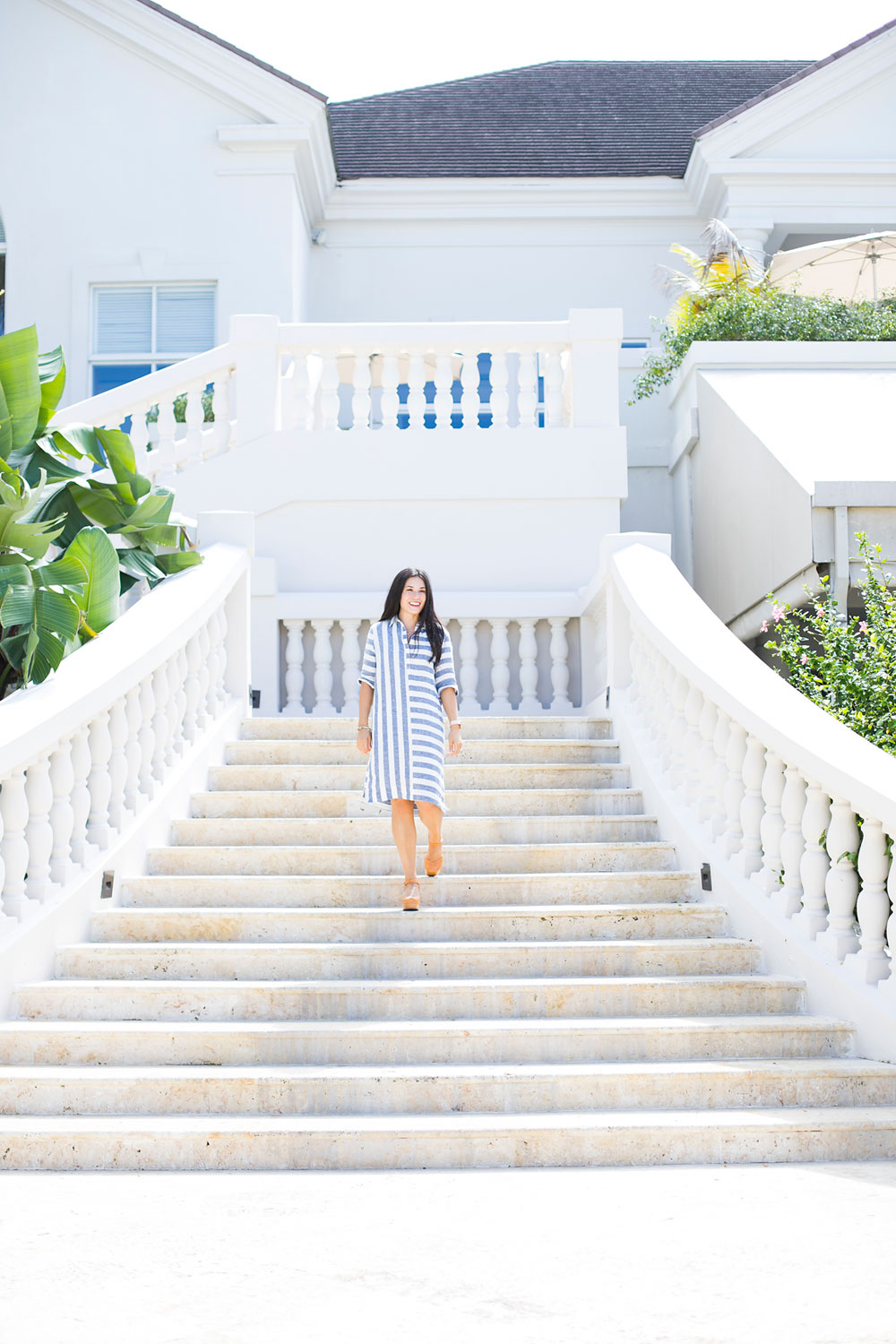 Walking down the grand staircase at Hyatt Ziva Rose Hall Jamaica