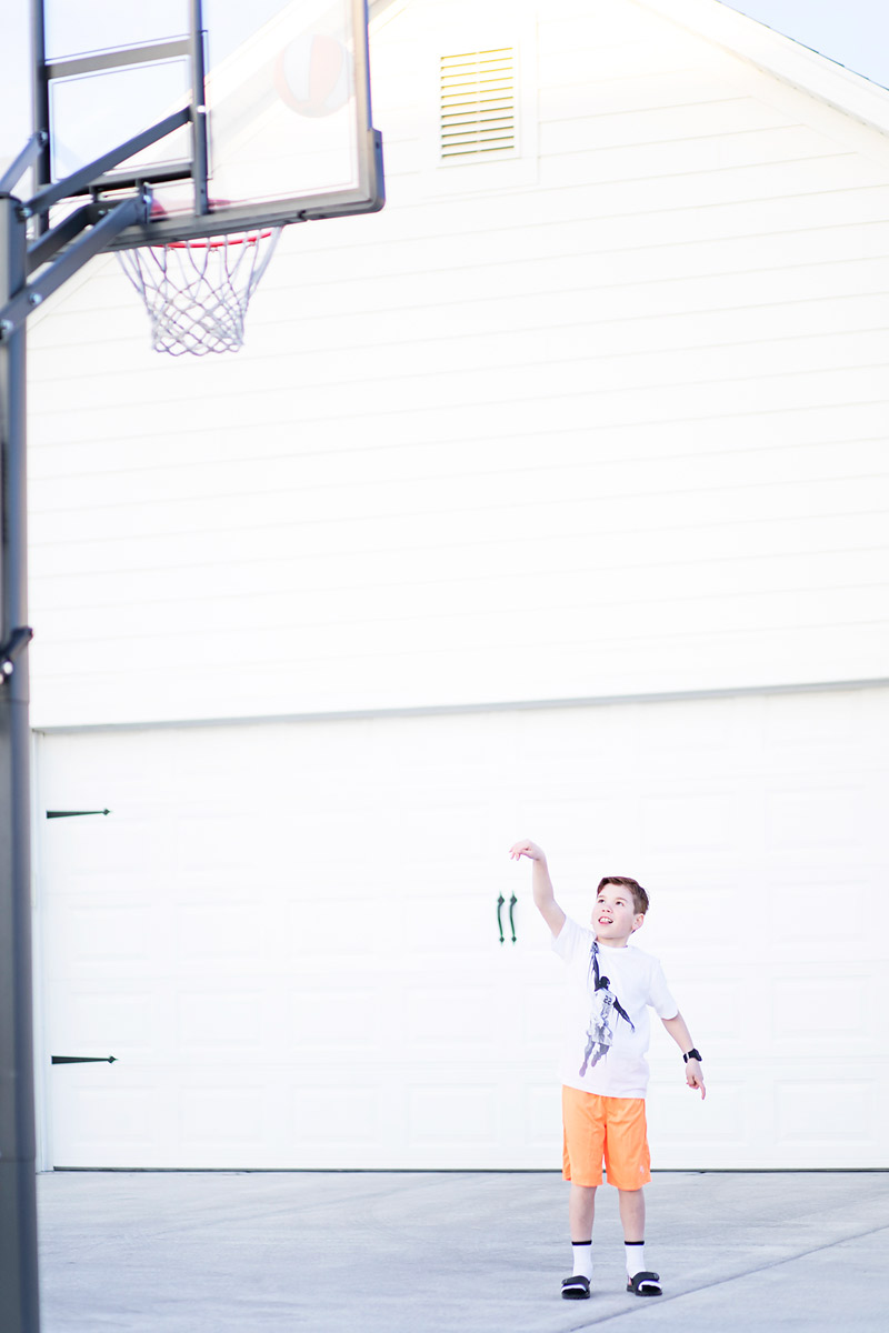 Boy Playing Basketball wearing PLACE Sport activewear line Basketball clothes for Boys