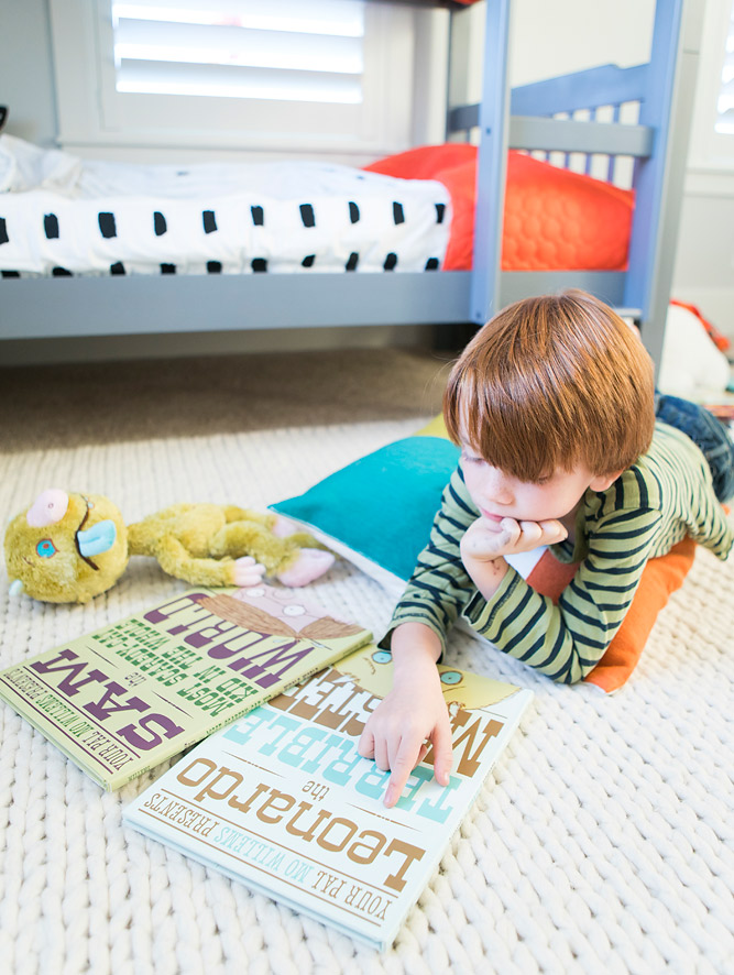 Boy Reading Mo Willems Books